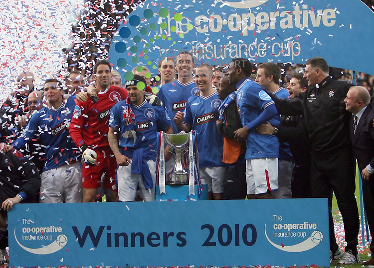 The Rangers team celebrate winning the cup during The Co-Operative League Cup Final 2009/10 between St Mirren and Rangers at The National Stadium Hampden Park Glasgow 21/03/10..Picture by Ricky Rae/universal News & Sport (Scotland).
