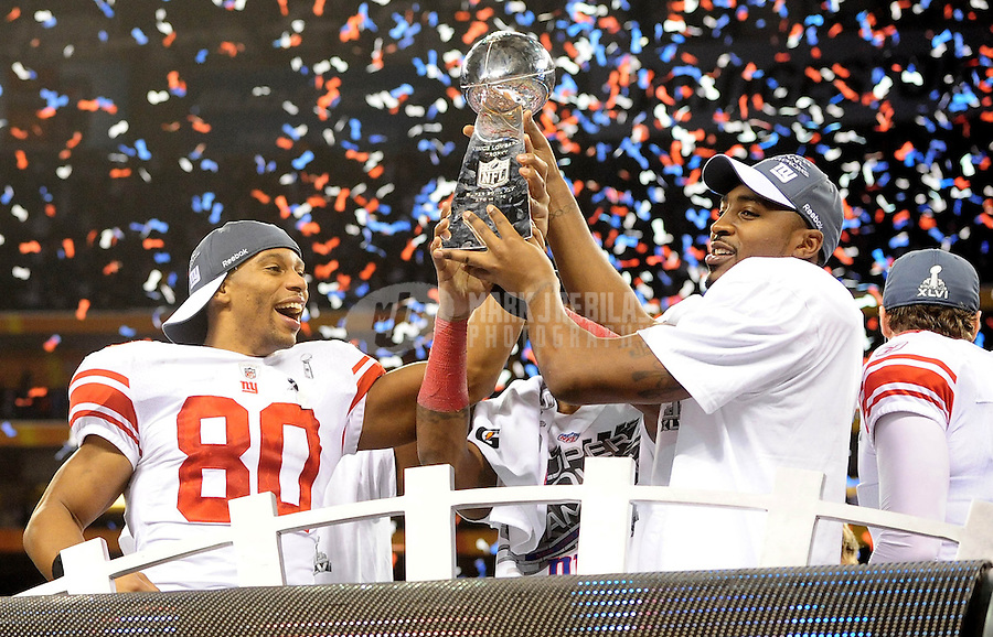 Feb 5, 2012; Indianapolis, IN, USA; New York Giants wide receiver Victor Cruz (80) and wide receiver Hakeem Nicks (right) celebrate with the Vince Lombardi Trophy after the Giants defeated the New England Patriots 21-17 in Super Bowl XLVI at Lucas Oil Stadium.  Mandatory Credit: Mark J. Rebilas-..