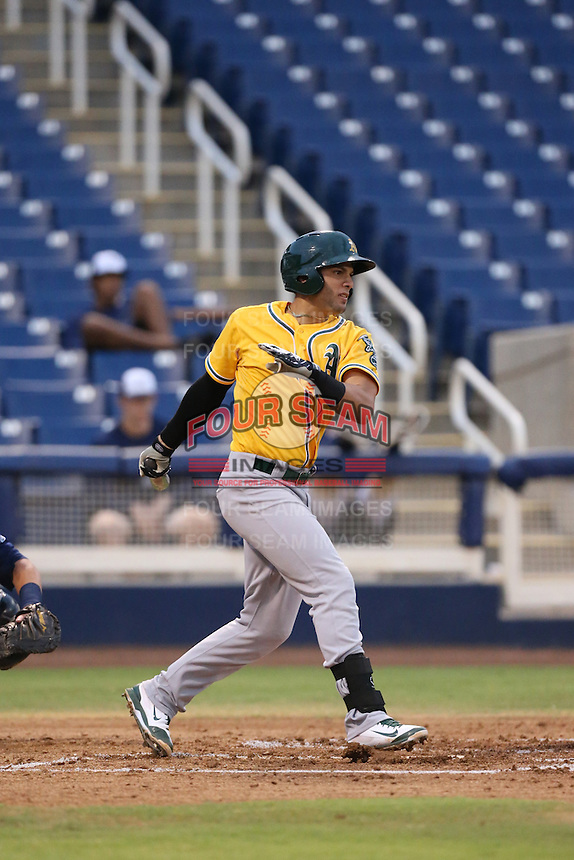 Luis Barrera (18) of the AZL Athletics bats during a game against the AZL Brewers at Maryvale Baseball Park on June 30, 2015 in Phoenix, Arizona. Brewers defeated Athletics, 4-2. (Larry Goren/Four Seam Images)