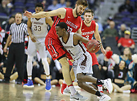 Washington, DC - March 10, 2018: St. Bonaventure Bonnies guard Nelson Kaputo (4) dribbles during the Atlantic 10 semi final game between St. Bonaventure and Davidson at  Capital One Arena in Washington, DC.   (Photo by Elliott Brown/Media Images International)