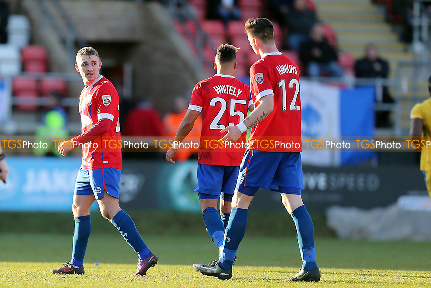 Jake Sheppard of Dagenham is congratulated after scoring the opening goal during Dagenham & Redbridge vs Chester, Vanarama National League Football at the Chigwell Construction Stadium on 4th February 2017