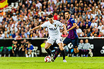 Kevin Gameiro of Valencia CF (L) in action against Sergio Busquets of FC Barcelona (R) during their La Liga 2018-19 match between Valencia CF and FC Barcelona at Estadio de Mestalla on October 07 2018 in Valencia, Spain. Photo by Maria Jose Segovia Carmona / Power Sport Images