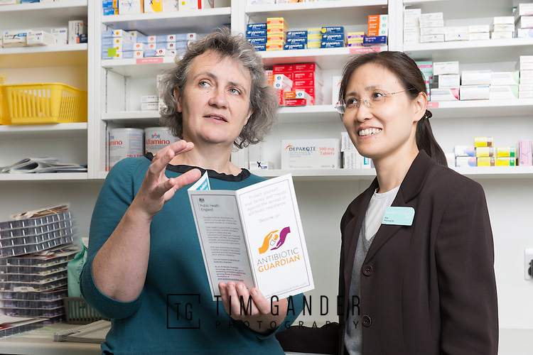 17/03/2015 Stock photo for NHS Bath and North East Somerset Clinical Commissioning Group. Portrait of prescribing advisor Elizabeth Beech taken at Lloyds Pharmacy, The Avenue, Combe Down, Bath, here with pharmacist Rita Lau (dark jacket).