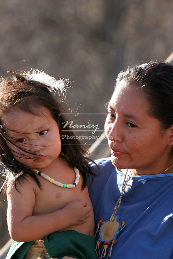 A Native American Indian mother holding her son