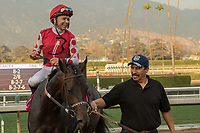 ARCADIA, CA  JANUARY 07:Mike Smith on #8 Midnight Bisou, shares a laugh with trainer Bill Spawr after winning the Santa Ynez Stakes (Grade ll) on January 7, 2018, at Santa Anita Park in Arcadia, CA. (Photo by Casey Phillips/ Eclipse Sportswire/ Getty Images)
