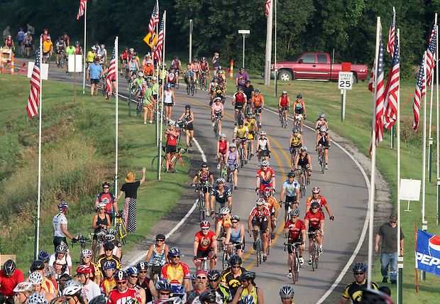 Riders cruise down a flag-lined road on their way into Brooklyn on July 29 along the RAGBRAI XXXIX route.