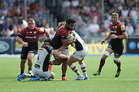 Man of the Match Billy Vunipola of Saracens is tackled by Charlie Matthews (left) and Luke Wallace of Harlequins during the Aviva Premiership semi final match between Saracens and Harlequins at Allianz Park on Saturday 17th May 2014 (Photo by Rob Munro)