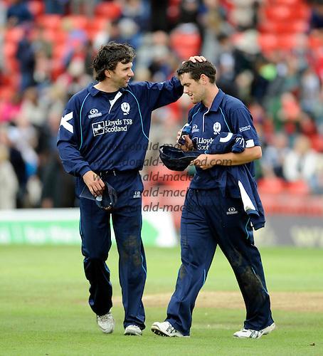 Scotland V Australia ODI at Grange CC, Edinburgh - Scotland' Fraser Watts (left) congratultaes Gordon Goudie on his 5 wicket haul - Picture by Donald MacLeod 27.08.09