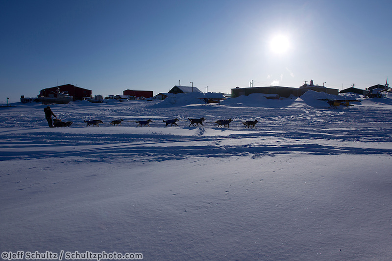 Sunday March 11, 2012  Brent Sass arrives on the sloug at Unalakleet.   Iditarod 2012.
