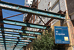 Savills estate agent sign All Enquiries on derelict factory building, Wet Dock, Ipswich, Suffolk, England, UK