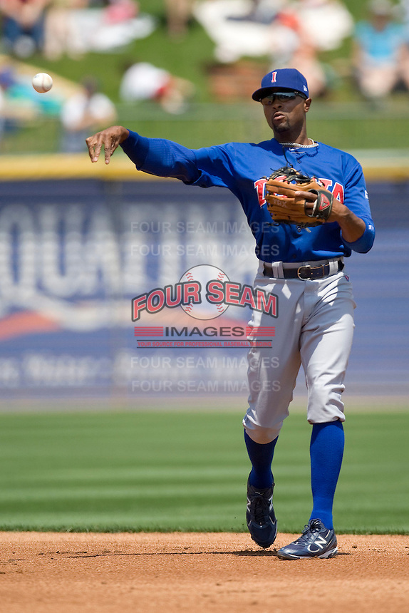 Iowa Cubs 2B Bobby Scales (11) throws the ball to first against the Round Rock Express on April 10th, 2011 at Dell Diamond in Round Rock, Texas.  (Photo by Andrew Woolley / Four Seam Images)