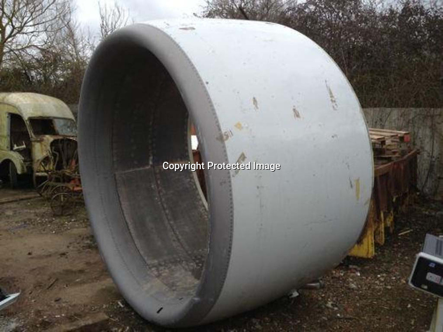 BNPS.co.uk (01202 558833)<br /> Pic: PhilYeomans/BNPS<br /> <br /> An engine cowling from a Boeing 737 before being transformed into bespoke furniture for the Jet Set.<br /> <br /> Two brother's have come up with ultimate in aircraft recycling - turning unwanted bits of redundant airliners into highly desirable - and highly expensive - bespoke items of furniture.<br /> <br /> Brett and Shane Armstrong from Kent scour the worlds aircraft graveyards looking for interesting items they can rescue from sad decay and with a lot of imagination and elbow grease convert into one-off gleaming items of furniture costing thousands of pounds.