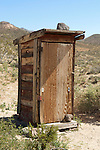 Outhouse with rock to keep it from blowing away in the wind