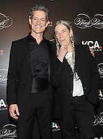 NEW YORK, NY - OCTOBER 19: Peter Twyman and Patti Smith attends Keep A Child Alive's Black Ball 2016 at Hammerstein Ballroom on October 19, 2016 in New York City. Photo by John Palmer/MediaPunch