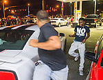 BATON ROUGE, LA -JULY 10: Protesters run through a gas station parking lot as law enforcement in riot gear charge the protesters to make arrest on July 10, 2016 in Baton Rouge, Louisiana. Alton Sterling was shot by a police officer in front of the Triple S Food Mart in Baton Rouge on July 5th, leading the Department of Justice to open a civil rights investigation. (Photo by Mark Wallheiser/Getty Images)