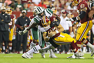 Landover, MD - August 16, 2018: New York Jets linebacker Jordan Jenkins (48) tackles Washington Redskins quarterback Colt McCoy (12) during the preseason game between New York Jets and Washington Redskins at FedEx Field in Landover, MD.   (Photo by Elliott Brown/Media Images International)