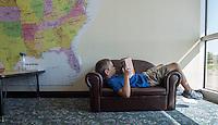 NWA Democrat-Gazette/J.T. WAMPLER Colton Howe reads Thursday Sept. 3, 2015 at the Ozark Montessori Academy at the Jones Center in Springdale.