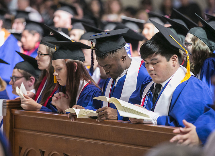 Students pray during the Baccalaureate Mass at the Saint Vincent de Paul Parish Church on DePaul University's Lincoln Park Campus Friday, June 9, 2017. The event was part of the 119th commencement ceremonies for the Chicago university. (DePaul University/Jamie Moncrief)