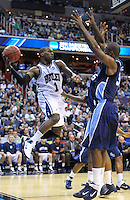 Shelvin Mack of the Bulldongs is trapped underneath the basket by the Monarch's defense. Butler defeated Old Dominion 60-58 during the NCAA tournament at the Verizon Center in Washington, D.C. on Thursday, March 17, 2011. Alan P. Santos/DC Sports Box