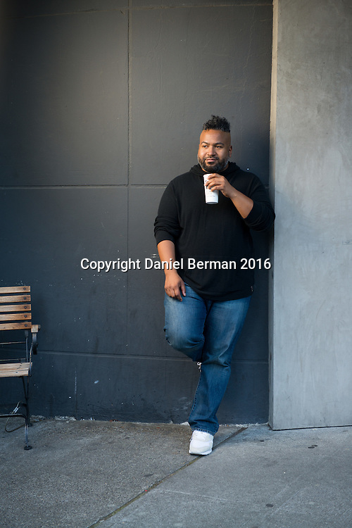 """KEXP DJ Larry Mizell, Jr. at Uptown Espresso, near his home in the South Lake Union neighborhood. The host of """"Street Sounds"""" is also a regular contributor to The Stranger newspaper. Photo by Daniel Berman for Discover South Lake Union"""