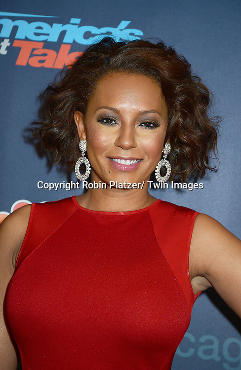 """Mel B in red Stella McCartney dress attends the """"America's Got Talent"""" pre show red carpet on September 17, 2013 at Radio City Music Hall in New York City."""
