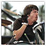 Dave Grohl of Foo Fighters sits in on drums with Queens of the Stone Age on Saturday, April 27, 2002