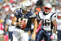10/24/10 San Diego, CA: San Diego Chargers quarterback Philip Rivers #17 and New England Patriots safety Josh Barrett #36 during an NFL game played at Qualcomm Stadium between the San Diego Chargers and the New England Patriots. The Patriots defeated the Chargers 23-20.
