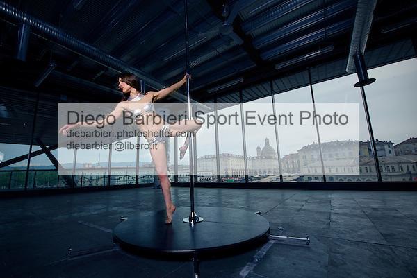 2 maggio 2015 - La pole dancer Valeria Bonalume posa durante la realizzazione del nuovo video al Palafuksas di Torino, sullo sfondo la città e il mercato di Porta Palazzo, Torino.