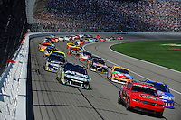 The field begins the pace lap with polesitter Greg Biffle (#16) and Carl Edwards (#99) leading the field.