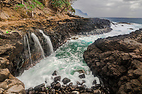 Shoreside waterfall, Hanalei Bay, on the island of Kauai, Hawaii. An interesting place to watch the pulsating sea.