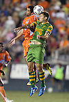 22 September 2012: Carolina's Austin da Luz (left) and Tampa Bay's Frankie Sanfilippo (right) challenge for a header. The Carolina RailHawks played the Tampa Bay Rowdies to a 0-0 tie at WakeMed Soccer Stadium in Cary, NC in a 2012 North American Soccer League (NASL) regular season game.