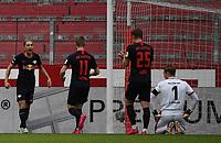 24th May 2020, Opel Arena, Mainz, Rhineland-Palatinate, Germany; Bundesliga football; Mainz 05 versus RB Leipzig; Kevin Kampl (RB Leipzig), Timo Werner (RB Leipzig), Daniel Olmo Carvajal (RB Leipzig) celebrate their goal, for 0:4, as goalie Florian Mueller (FSV Mainz 05)  sits frustrated