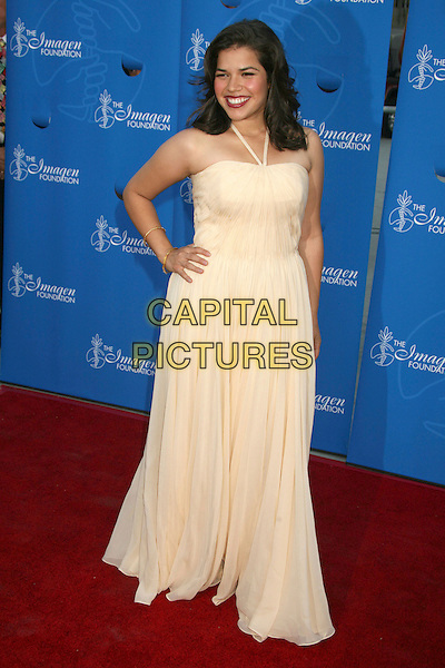 AMERICA FERRERA.22nd Annual Imagen Awards for Excellence in Latino Entertainment at the Walt Disney Concert Hall, Los Angeles, California, USA,.28 July 2007..full length cream dress long maxi hand on hip halterneck pale yellow.CAP/ADM/BP.©Byron Purvis/AdMedia/Capital Pictures.
