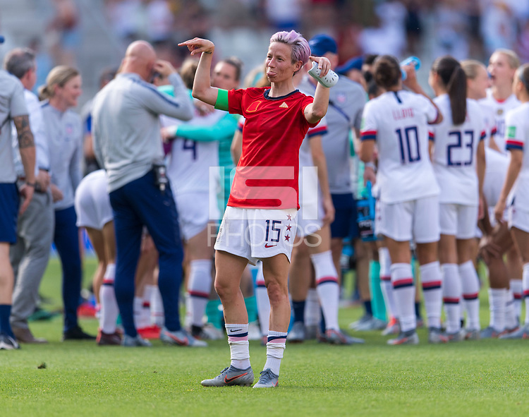 REIMS,  - JUNE 24: Megan Rapinoe #15 salutes the crowd during a game between NT v Spain and  at Stade Auguste Delaune on June 24, 2019 in Reims, France.