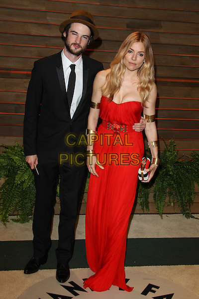 WEST HOLLYWOOD, CA - MARCH 2: Sienna Miller, Tom Sturridger attending the 2014 Vanity Fair Oscar Party in West Hollywood, California on March 2nd, 2014. <br /> CAP/ADM/UPA<br /> &copy; UPA/AdMedia/Capital Pictures