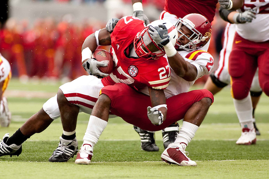 24 October 2009: Iowa State cornerback James Smith brings down Nebraska running back Dontrayevous Robinson in the second half at Memorial Stadium, Lincoln, Nebraska. Iowa State defeated Nebraska 9 to 7.