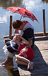 A vintage young mom and child enjoying the summer relaxing on a pier