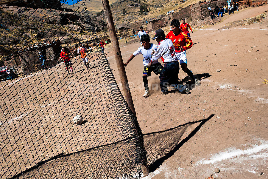 Indigenous men play football on a dusty football pitch in the rural mountain community close to Puno, Peru, 6 August 2012. Football, the most popular sport in Latin America, is widely played even in the remote and sparsely populated places in the mountains and jungles. The 2014 FIFA World Cup in Brazil is the most eagerly anticipated sporting event for all Latin Americans.