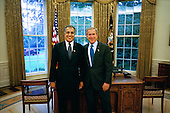 United States President George W. Bush stands with Dr. Zalmay Khalilzad of Maryland, who he has nominated as Ambassador to Afghanistan in the Oval Office Monday, September 22, 2003. Dr. Khalilzad currently serves as Special Presidential Envoy to Afghanistan, a role he will retain after he is confirmed as Ambassador.  <br /> Mandatory Credit: Eric Draper / White House via CNP