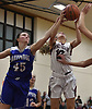 Eleni Glodowski #10 of Whitman, right, and Nicole Petrocelli #45 of Hauppauge battle for a rebound during a non-league tournament game at Whitman High School on Friday, Nov. 30, 2018. Whitman won in overtime by a score 51-46.
