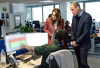 19/03/2020 - Picture released by Kensington Palace of Prince William Duke of Cambridge and Kate Duchess of Cambridge talking with staff during a visit to the London Ambulance Service 111 control room in Croydon on Thursday to meet ambulance staff and 111 call handlers who have been taking NHS 111 calls from the public, and thank them for the vital work they are doing. Photo Credit: ALPR/AdMedia