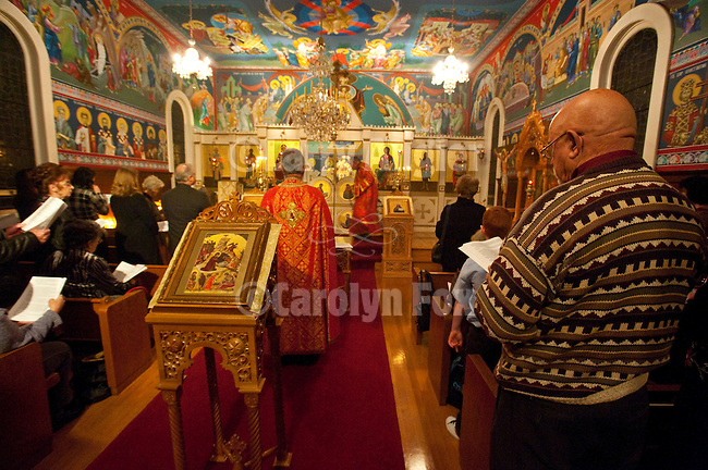 Christmas Eve Vigil Service at St. Sava Serbian Orthodox Church, Jackson, Calif.--Roy Ratkovich, right, follows the service conducted by Father Steve and Deacon Triva.
