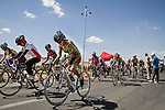 SULAIMANIYAH, IRAQ: Cyclists leave the start line at the start of the individual race. Nyan Yassin is closest to camera.<br /> <br /> Nyan Yassin, 24, is a professional competitive cyclist in Sulaimaniyah in the semi-autonomous region of Iraqi Kurdistan.  She is the captain of an all-female club called Newroz Club, which is the only cycling club for women in Sulaimaniyah, although there are other clubs around Iraq.  She trains and competes on roads that are badly surfaced and busy with traffic.<br /> <br /> Nyan was the first woman to start cycling in Sulaimaniyah.  She was always competitive and after trying her hand at different sports she settled on cycling.  She is now the top female cyclist in Iraq.  Her nickname is MigMig after the noise made by the cartoon character Roadrunner.<br /> <br /> Despite being clearly talented at her sport Nyan knows that in a couple of years she will have to get married and then abandon it as, in the traditional society that Kurdistan is, being a wife and a competitive sportswoman at the same time is not an option.<br /> <br /> Photo by Gona Hassan/Metrography