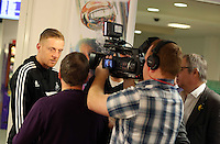 Wednesday 26 February 2014<br /> Pictured: Head coach Garry Monk (L) gives an interview at Cardiff Airport.<br /> Re: Swansea City FC travel to Italy for their UEFA Europa League game against Napoli.