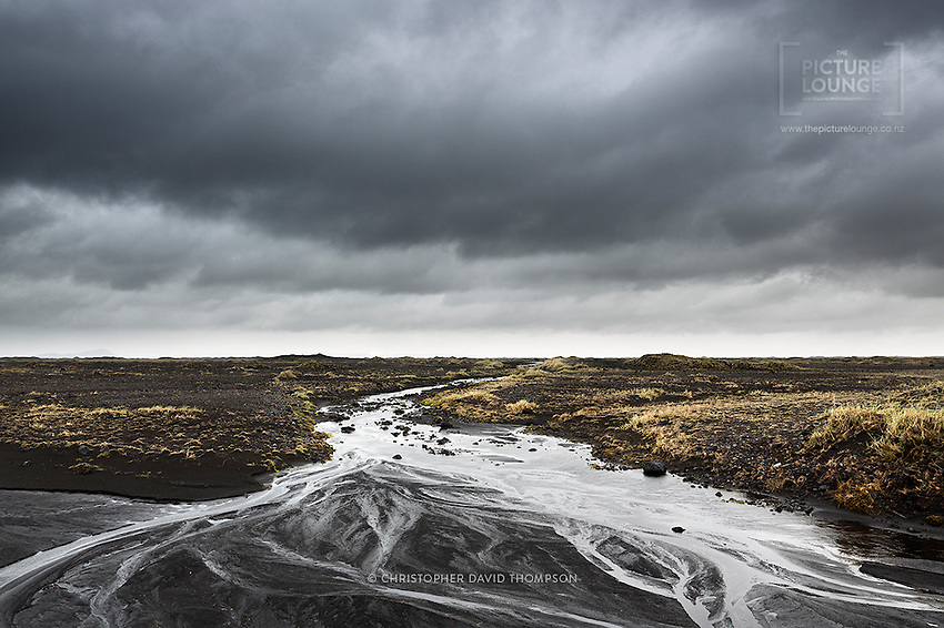 The dramatic tones of Iceland captivated NZ landscape and travel photographer Christopher Thompson. Omnipresent grey clouds marched across the landscape of dark lava here in South Iceland.