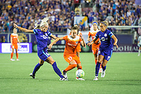 Orlando, Florida - Saturday, April 23, 2016: Houston Dash midfielder Andressa Machry (17) splits both Orlando Pride midfielder Kaylyn Kyle (6) and defender Monica Hickman Alves (21) during an NWSL match between Orlando Pride and Houston Dash at the Orlando Citrus Bowl.