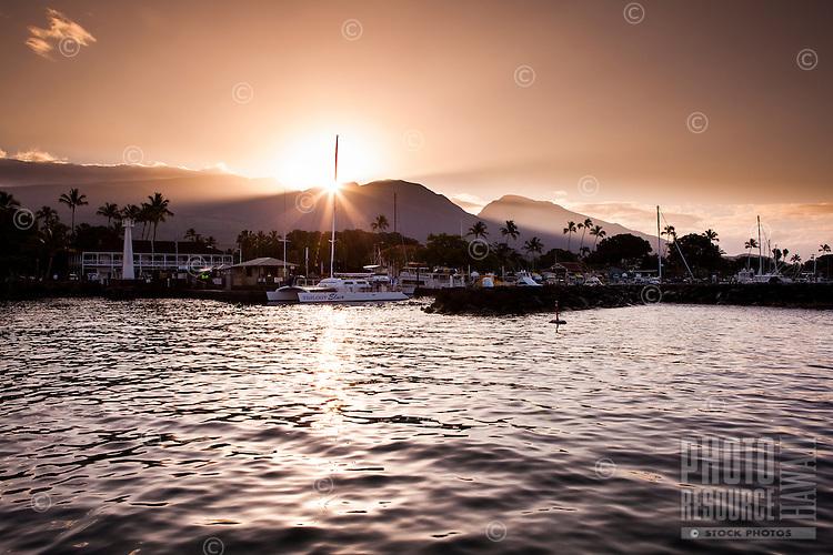 Sunset view of Lahaina Harbor off the coast of Maui.