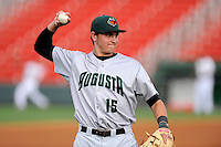 Third baseman Ryder Jones (15) of the Augusta GreenJackets warms up before a game against the Greenville Drive on Thursday, May 22, 2014, at Fluor Field at the West End in Greenville, South Carolina. Jones was a second-round pick of the San Francisco Giants in the 2013 First-Year Player Draft. He is listed as the Giants' No. 15 prospect by Baseball America. Greenville won, 7-2. (Tom Priddy/Four Seam Images)