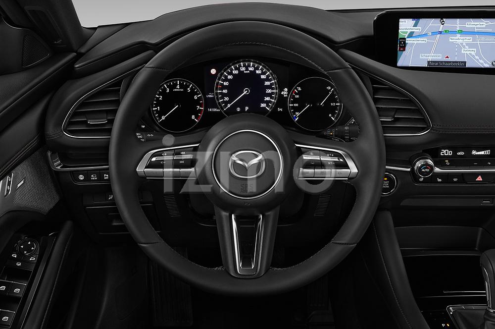 Car pictures of steering wheel view of a 2019 Mazda Mazda3 Skycruise 5 Door Hatchback