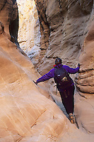 Hiking in a Slot Canyon, near Hackberry Canyon, Escalante National Monument, Utah